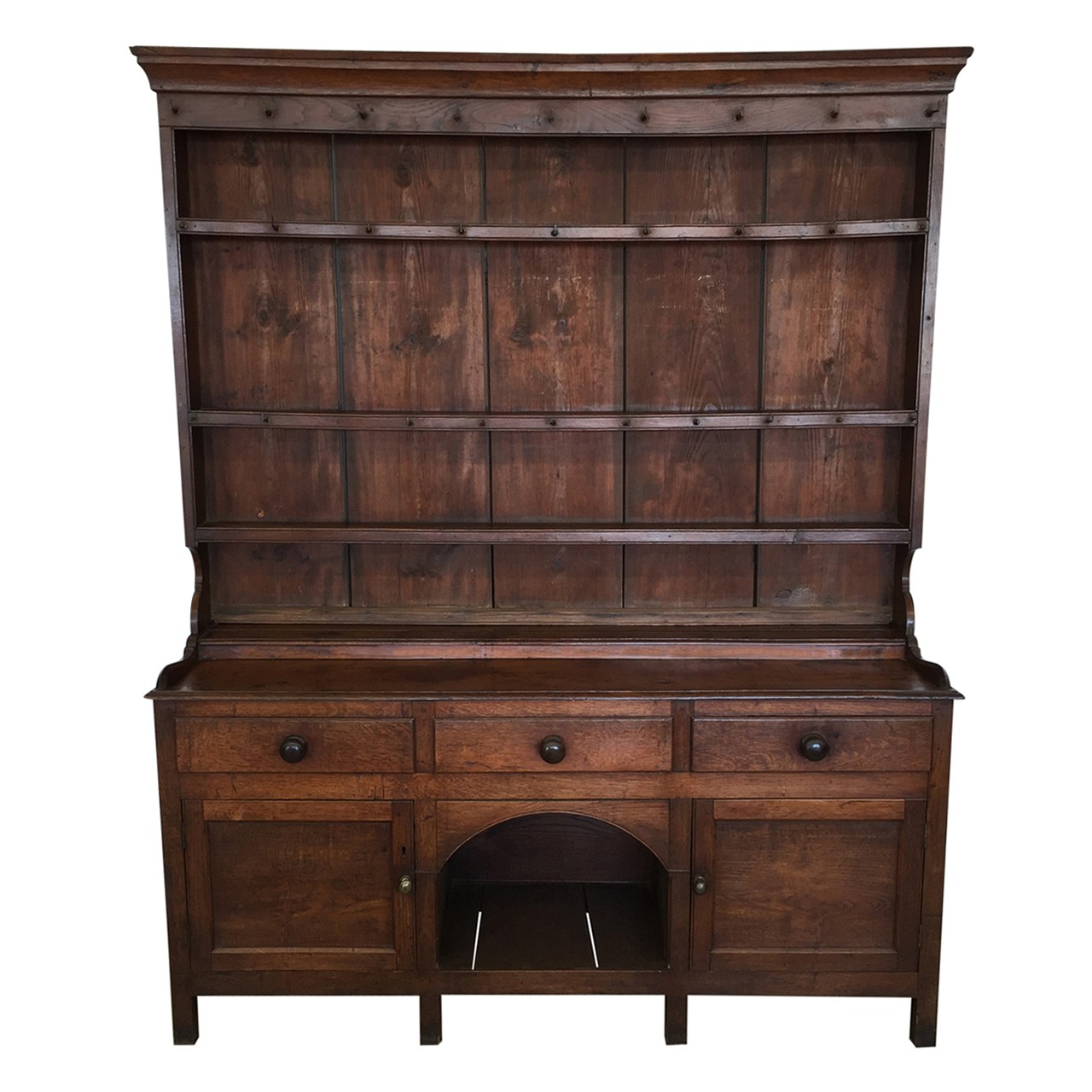 18th century Welsh oak dresser with three drawers and dog kennel.